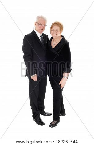 A lovely older couple standing in suits holding each other in full lengths isolated for white background.