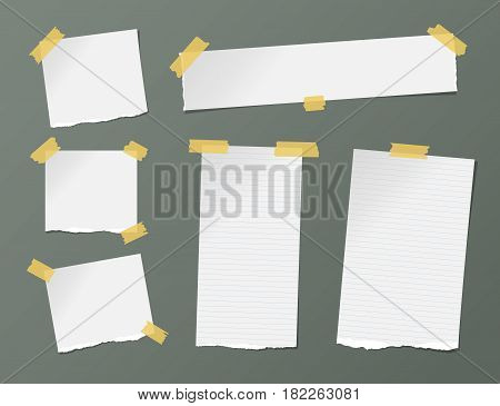 Different size white ruled note, notebook, copybook sheets, strips stuck with yellow sticky tape on dark background.