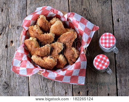 Chicken wings fried in breading with tomato sauce, fast food.