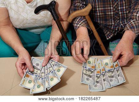 Old Couple And Money.