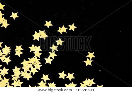 Gold stars on black background
