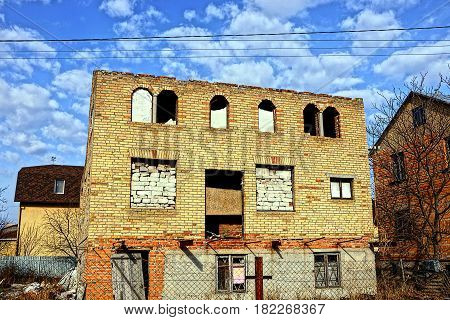 The facade of the destroyed brick house