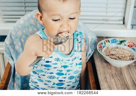 Baby Eating Porridge