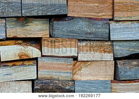 Pine rectangular firewood stacked in a pile