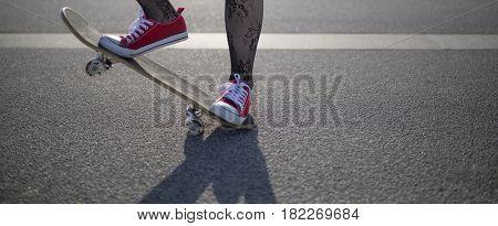 Girl riding a skateboard