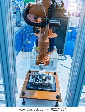 robotic arm machine tool at industrial manufacture plant,Smart factory industry 4.0 concept.
