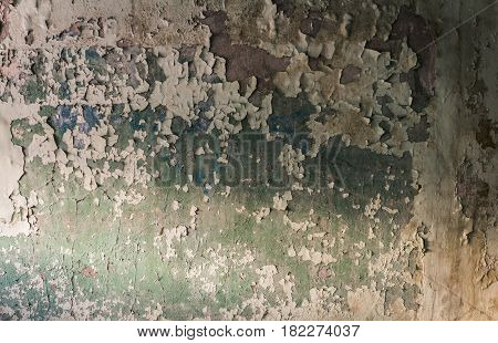 Close-up peeling paint on wall seamless texture.