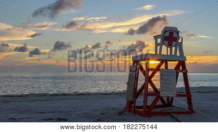 OCT 10, 2016 - TARPON SPRINGS FL: A lone lifeguard station on the beach during sunset.