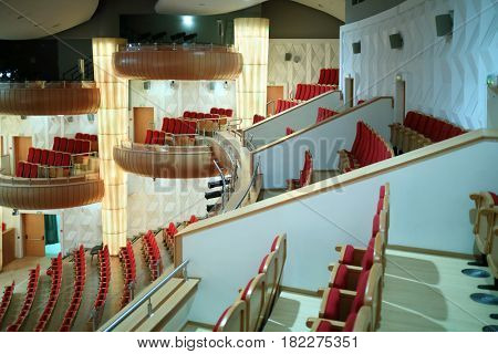 MOSCOW - OCT 25, 2016: Seats, balconies in Moscow State Music Theatre of Russian folk song concert hall in Diamond hall business center