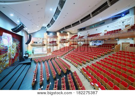 MOSCOW - OCT 25, 2016: Moscow State Music Theatre of Russian folk song concert hall with red seat in Diamond hall business center, Translations of text on paper - reserve, nominee