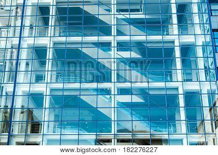 Glass Facade Of The Building With Escalator.