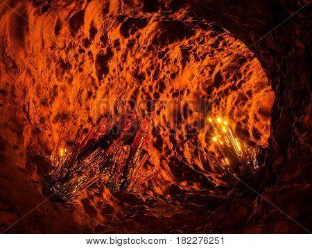 Magic illuminated cave with crystal inside. 3d illustration