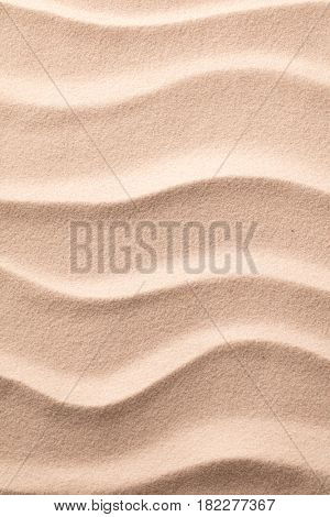 ripples in sand on beach , texture background.