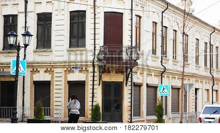 Old building Kabardinskaya Street, the historical center of Nalchik. It is a pedestrian zone for citizens walks, where they show their art, young artists, musicians, craftsmen and confectioners.