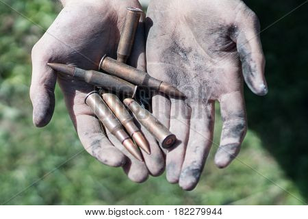 Bullets from AK Kalashnikov AK 47 in the hands of a man. Concepts of war, conflict in Syria