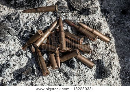 Bullets from AK Kalashnikov AK 47 in heat and coal. Concepts of war, conflict in Syria