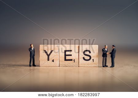 Wooden tiles with letters spelling out the word Yes. Business concept.