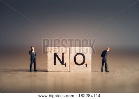 Wooden tiles with letters spelling out the word No. Business concept.