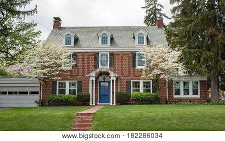 Brick House with Flowering Dogwood Trees