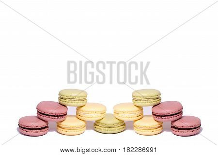Colorful Macaroons. Pyramid Of Macaroons Sweet Macarons. Isolated On White Background. A Pyramid Of