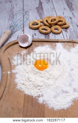 Baking Concept. Sprinkled Flour And Eggs On Wooden Cutting Board, Cooking Ingredients. Prepare For M