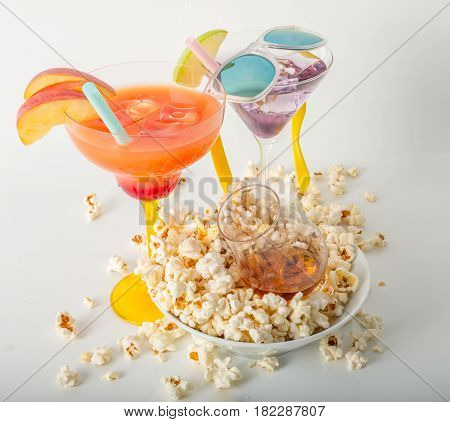 Two Color Drinks And Whisky Single Malt, Salty Popcorn In A Bowl And Scattered Around