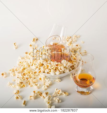 Set Of Glasses Of Single Malt Whisky, Salty Popcorn In A Bowl And Rozypane Around