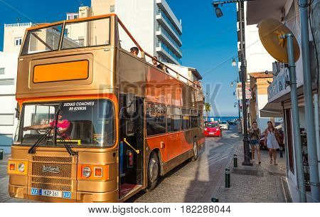 LARNACA CYPRUS - AUGUST 27 2016: Open Sightseeing Tour Bus on the street of Larnaca.