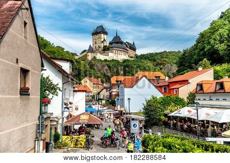 KARLSTEJN CZECH REPUBLIC - SEPTEMBER 03 2016: Restaurants and souvenir shops on the main road leading to Karlstejn Castle. Karlstejn Village Central Bohemia Czech Republic.