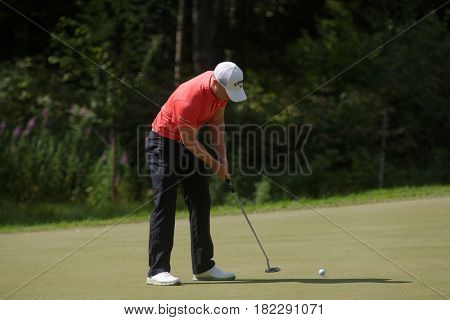 TSELEEVO, MOSCOW REGION, RUSSIA - JULY 26, 2014: David Horsey of England in action in the Tseleevo Golf & Polo Club during the 3rd round of M2M Russian Open. This tournament is part of European Tour
