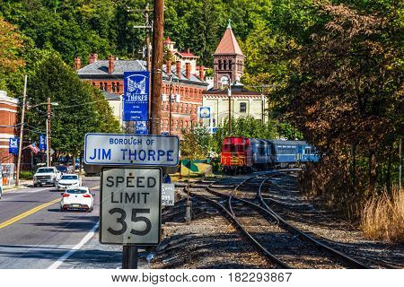 JIM THORPE PENNSYLVANIA - SEPTEMBER 28: Railroad tracks along Route 209 lead into Scenic Jim Thorpe on September 28 2016 in Pennsylvania.