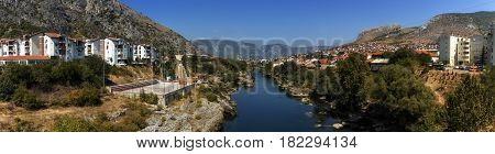 Panoramic view of Neretva river and old city of Mostar by day, Bosnia and Herzegovina
