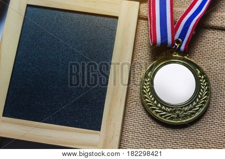 Blank Copy Space Backround On Small Green Board With Coin Or Medal Prize
