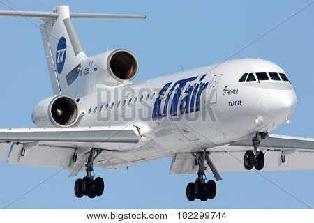 VNUKOVO, MOSCOW REGION, RUSSIA - MARCH 23, 2014: Utair Yakovlev Yak-42 landing at Vnukovo international airport.