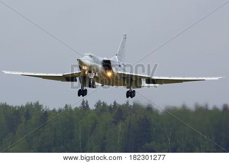 KUBINKA, MOSCOW REGION, RUSSIA - MAY 18, 2015: Tupolev Tu-22M3-R RF-94239 bomber of Russian Air Force landing at Kubinka air force base.