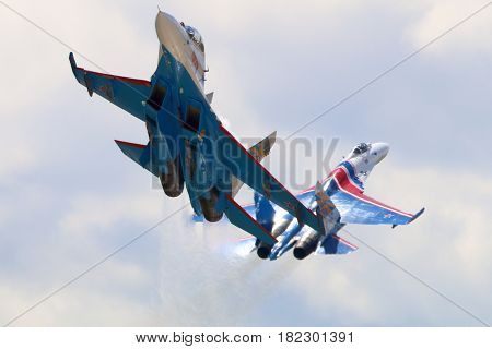 KUBINKA, MOSCOW REGION, RUSSIA - JUNE 17, 2015: Pair of Sukhoi Su-27 jet fighters of Aerobatics team Russian Knights at Kubinka air force base during Army-2015 forum