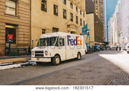 New York City USA - March 20 2017: FedEx van parked on the street in low Manhattan. FedEx Corporation is an American global courier delivery.