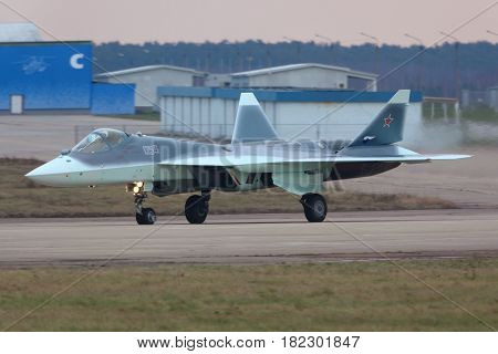 ZHUKOVSKY, MOSCOW REGION, RUSSIA - NOVEMBER 20, 2013: Sukhoi T-50 PAK-FA 055 BLUE prototype is a brand new fifth generation jet fighter shown while arriving Zhukovsky.