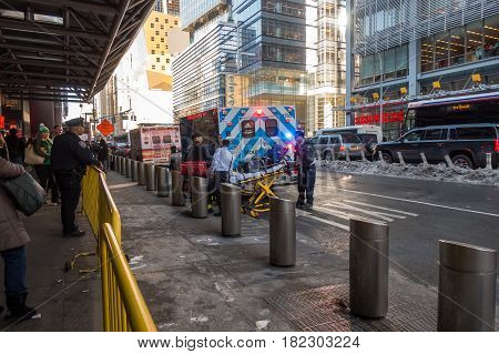 New York City USA - March 17 2017: FDNY and Mount Sinai Ambulance flashing lights siren blasting with first ait kit and stretcher in Manhattan.