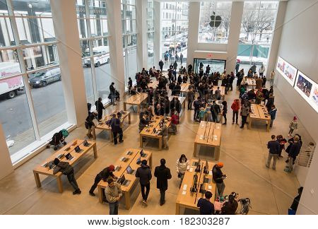 New York CityUSA - March 18 2017: Interior view to the Apple Store. This is one of the most profitable Apple shops worldwide located at the Fifth Avenue in Manhattan.