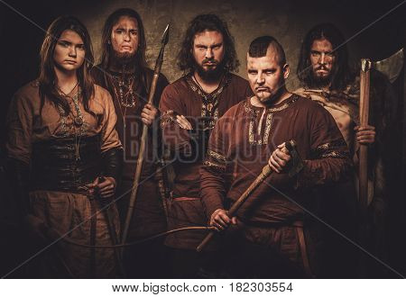 Mad vikings warriors posing in studio.