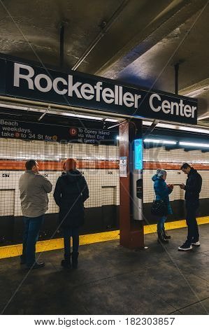 New York Usa - March 18 2017: Passengers waiting in the NYC Rockefeller Center station Subway.