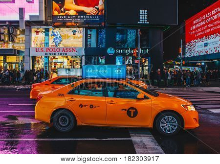 New York City - March 18 2017 : Yellow taxi cab driving in a New York City Street.