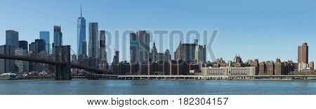 View of Brooklyn Bridge and Manhattan skyline WTC Freedom Tower from Dumbo Brooklyn. Brooklyn Bridge is one of the oldest suspension bridges in the USA