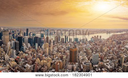 The New York City USA .Manhattan downtown and skyline skyscrapers at sunset with the Hudson river and Brooklyn bridge. Extreme Panorama