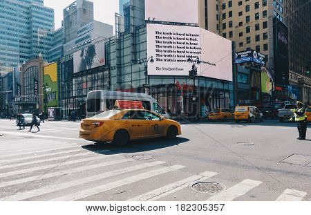 New York City USA - March 21 2017: Yellow Taxi cabs on the street of New York. The architecture of Manhattan with symbolic yellow taxis. The financial and cultural capital of the world.