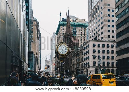 New York City USA - March 18 2017. The Trump Tower on Fifth Avenue typical skyscrapers common in Manhattan and old gold analogue hour.