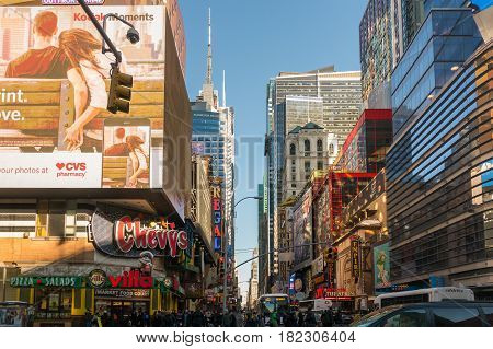 New York City USA- March 17 2017: Times Square featured with Broadway Theaters and animated colorful LED signs stores and lots of tourists and locals is a symbol of NYC and the USA in Manhattan.