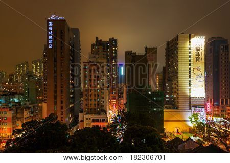 Cityscape With Skyscrapers In Kowloon, Hongkong, At Night