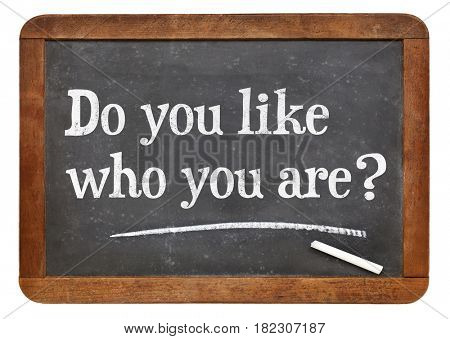 Do you like who you are? A question in white chalk on a vintage slate blackboard